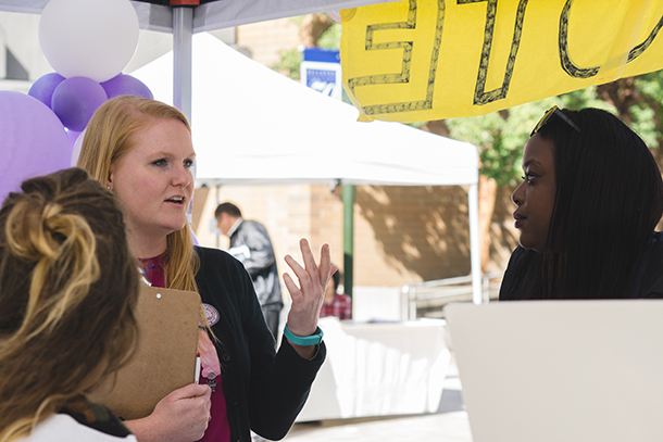Katie Stultz at the OSLA booth helps explain voter registration to students.