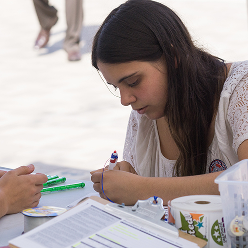 An OSLA representative showing a student how to register to vote.