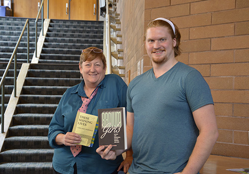 Tammi Doyle (director) and lead actor Jack Anderson holding the book and script for the upcoming play These Shining Lives