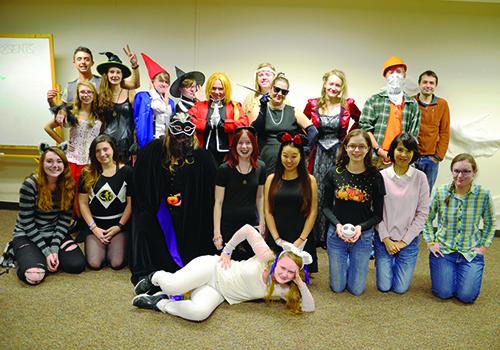 Members of the ASL student program enjoy craft night.