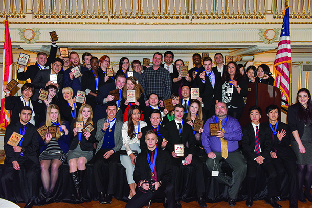 Bellevue DECA students holding their awards.
