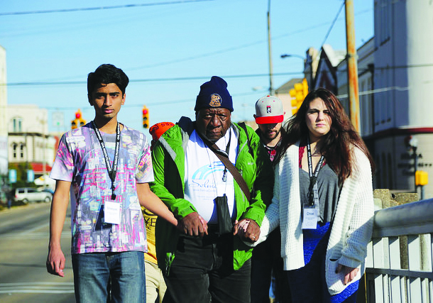 BC students Shreya Ramen and Chloe Copoloff with a community member from pilgrimage marching in Selma.