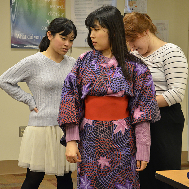 Trying on a kimono at the workshop.
