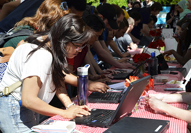 BC students vote at the BBQ for free meal tickets.
