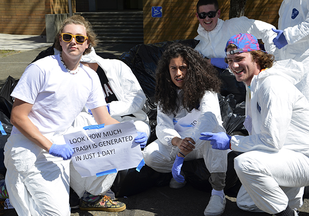 Students at the waste audit posing in Tyvek suits.