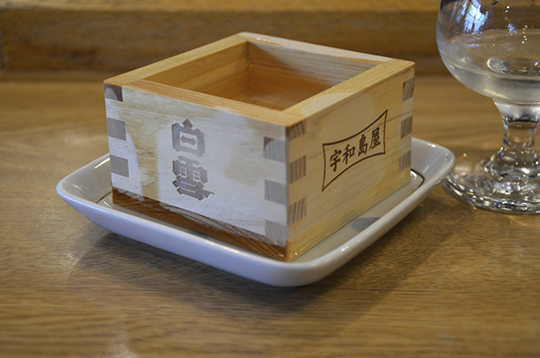 Cold sake served in a wooden box.