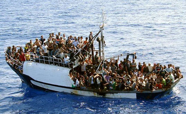 AP photo of boat with immigrants