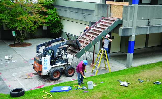 workers installing stairs