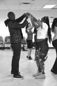 Vanessa Villalobos teaching a participant salsa dance. Alyssa Brown / The Watchdog