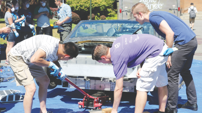 Students building a carbon fiber car at Bellevue College.