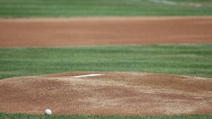 a baseball sitting on an empty pitcher's mound